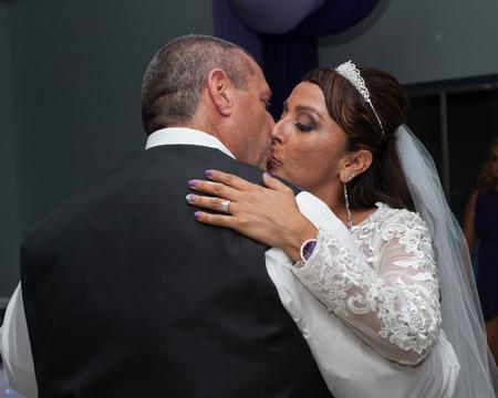 closes eyes: Bride closes eyes as she kisses the groom