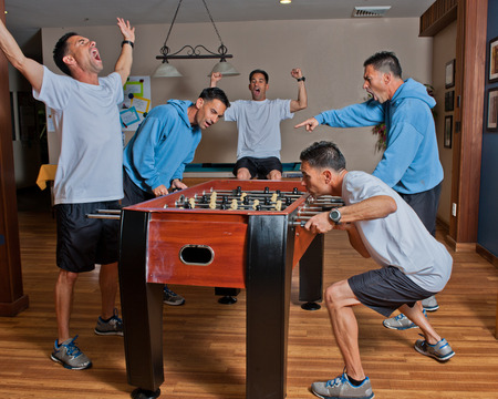 foosball: Many moods of just one game of foosball Stock Photo