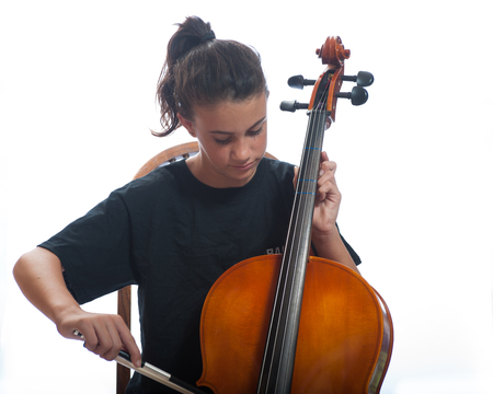 rehearse: Close up view of girl playing her cello Stock Photo