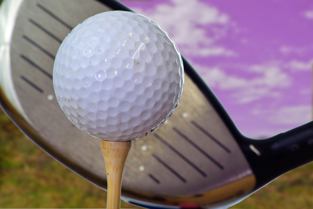 Driving the golf ball off the tee.