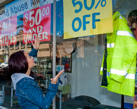 Woman thrilled to find a bargain Stock fotó