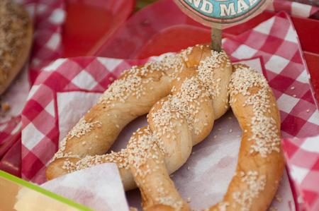 pretzel: Large salty pretzel for a snack.