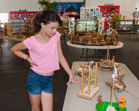 interested: Girl child interested in the wooden toys. Stock Photo
