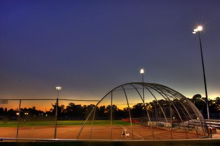 backstop: Dusk falls over the softball fields