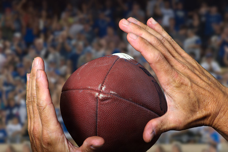 tight focus: Hands catching the football