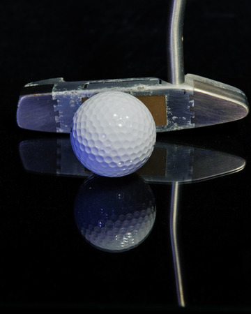 putter: Reflected golf ball and putter Stock Photo