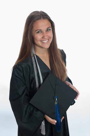 mortar hat: Female graduate smiling with mortar hat off. Stock Photo