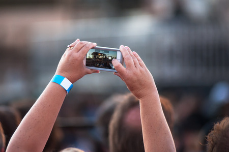 capturing: Capturing memories with the smartphone. Stock Photo