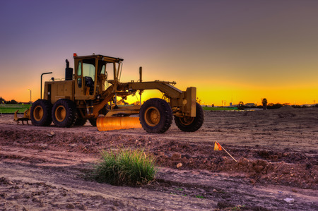 Road grader sitting alone on the job site.