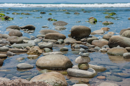 balanced rocks: Delicate and balanced stack of rocks at the beach.