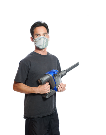 vaccuum: Middle age man wearing dust mask with vacuum Stock Photo