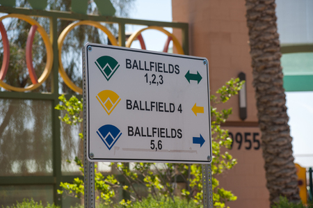 Sign shows directions to each softball field.
