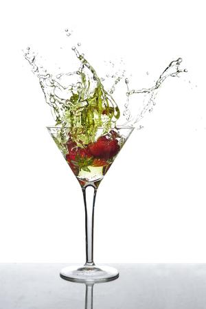 fruit of the spirit: Strawberries splashing into a martini glass