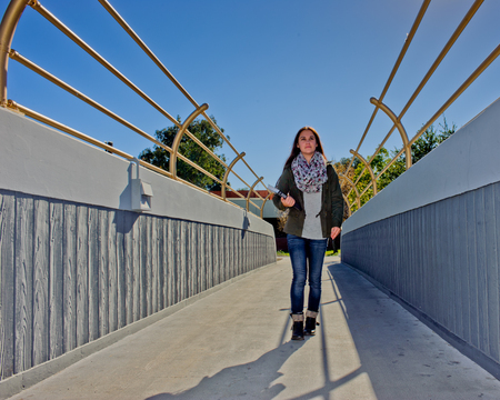 closer: Closer view of female student on overpass. Stock Photo