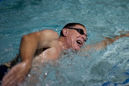 laps: Senior age man breathing between strokes.
