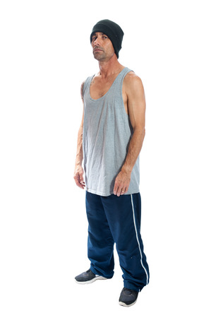 felon: Middle age male thug wearing tank top and beanie. Stock Photo