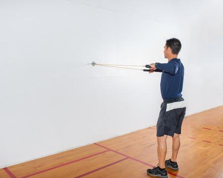 alternate: Middle age man demonstrating alternate rear deltoid strength exercise at end position. Stock Photo