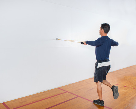 deltoid: Middle age man demonstrating single leg rear deltoid strength exercise at end position.