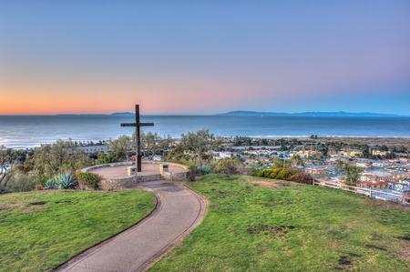 dais: Cross on left with city of Ventura below.