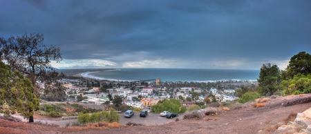 coastal city: Panoramic view of rain clouds over the small, coastal city. Stock Photo