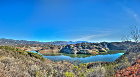 rocks water: Panoramic view of California lakes western shore of Casitas and low water line.