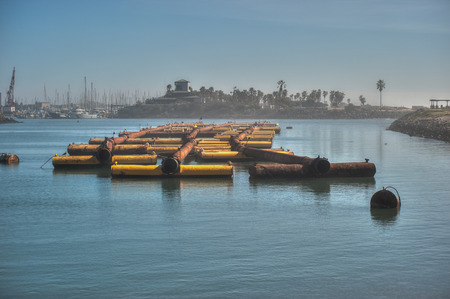 staging: Foggy marina used as staging area for pipe used to dredge Ventura Harbor.