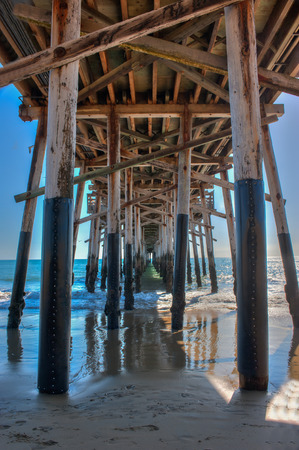 wooden joists: Tight view of Balboa Pier from below the deck.