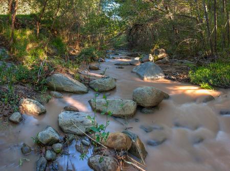 runoff: Panoramic view of Santa Paula Creek with running water.