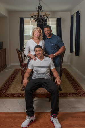 multiracial family: Wide view of handsome son seated with his multi-racial family.