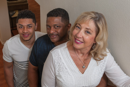 multiracial family: Tight view of multiracial family lined up on stairs.
