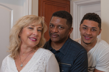 multiracial family: Tight view of multiracial family lined up. Stock Photo