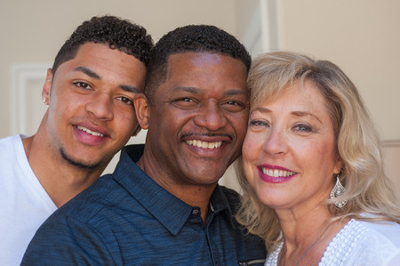 multiracial family: Tight view of multiracial family with smiling father.