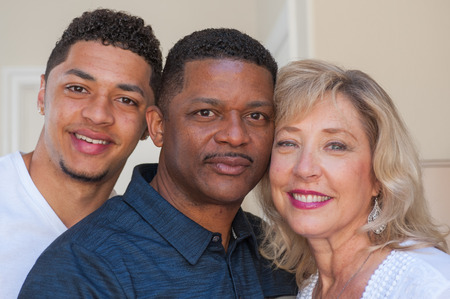 multiracial family: Tight view of multiracial family with serious father.