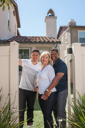 multiracial family: Wide view of multiracial family in backyard with mom in middle.