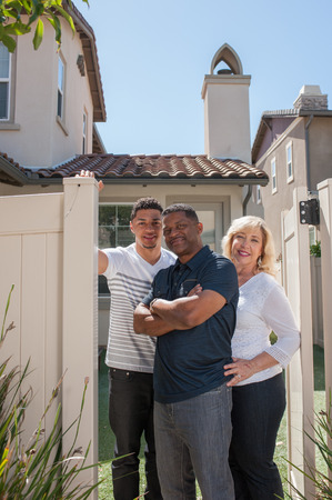 multiracial family: Wide view of multiracial family in backyard with dad in middle.