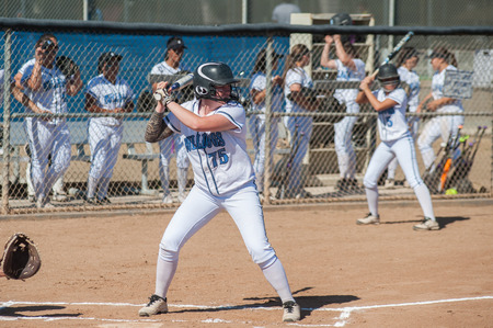High school softball player in her batting stance.