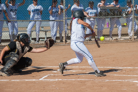 softball player: Strong softball player in black uniform expecting to catch the ball. Stock Photo