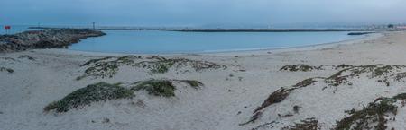 sand harbor: Panoramic view of harbor sand dunes under overcast sky. Stock Photo