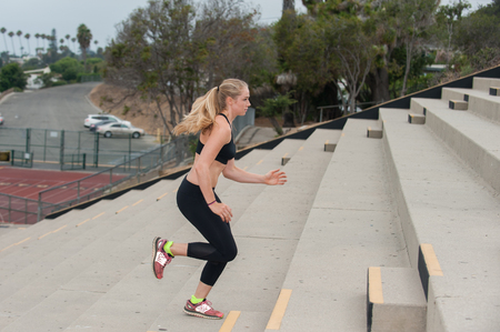 concrete steps: Athlete in black tights training on concrete steps. Stock Photo