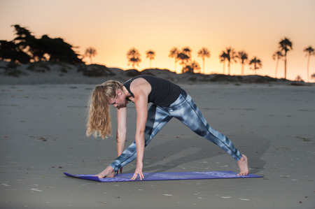 Sunrise Yoga session in Separated Leg Head to Knee pose.