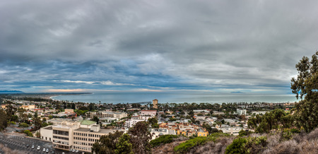 forcast: Ominous rain clouds moving over panoramic city of Ventura as sun rises.