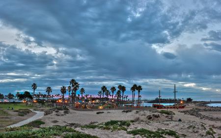 Panoramic of Ventura Marina Park lights shining under threatening clouds. Stock Photo