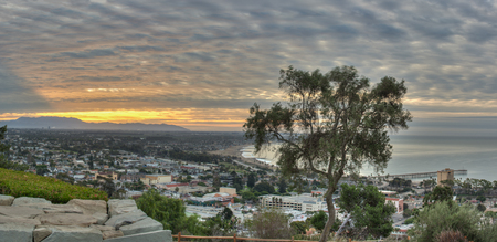 Cirrocumulus clouds wafting over cityscape of Ventura.