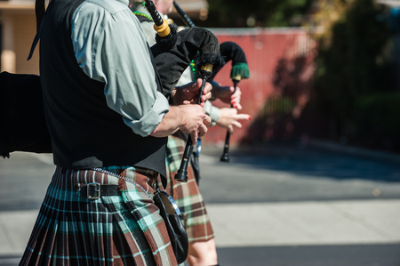 bagpipe: Irish bagpipe players waking along the parade route.