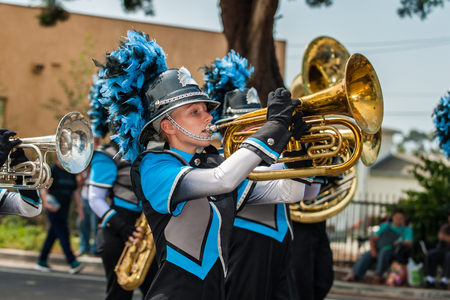 Marching band female baritone player in the number one position. Stock Photo - 83420603