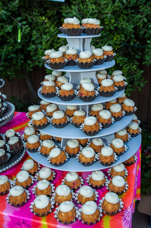 Hospitality accommodations feature a tower of mini bundt cupcakes with swirled frosting.