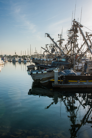 Combination of large and small fishing boats at dock. Stock Photo