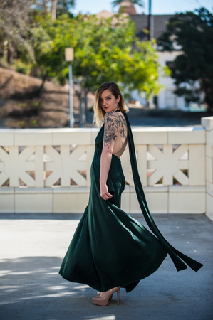 Pretty Young Woman In Emerald Green Formal Gown Halter Top Twirling