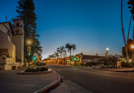 Gradient morning sky behind Ventura Mission looking up Main Street lights on February 24, 2018 in California, United States.