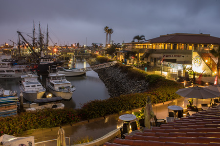 Looking over water front cafe and dive shop in the calm morning lights of winter rain.  Shot on March 3, 2018 in Ventura, California, United States.